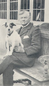 Jerome K Jerome, seated, with his dog